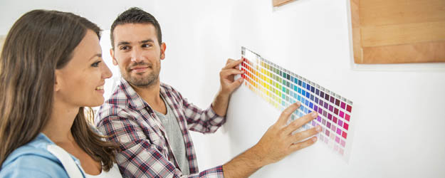 Man and Woman checking wall paint colors